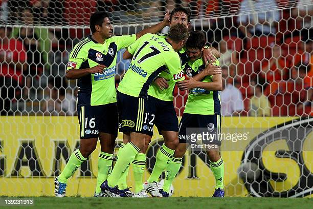 Marco Rojas of the Victory celebrates with team mates after scoring a goal during the round 20 ALeague match between the Brisbane Roar and the...