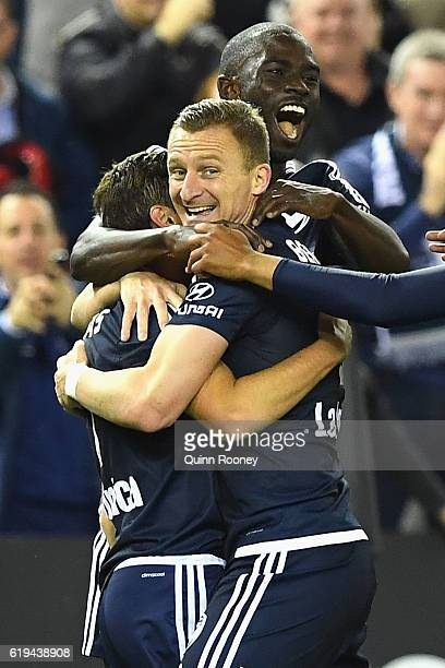 Marco Rojas of the Victory is congratulated by Besart Berisha and Jason Geria after scoring a goal during the round four ALeague match between the...