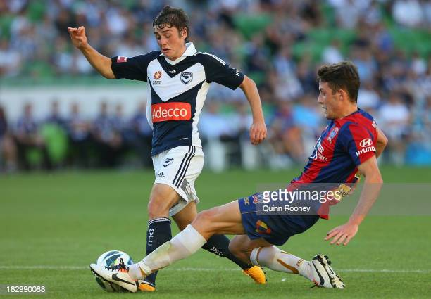 Marco Rojas of the Victory is tackled by Scott Neville of the Jets during the round 23 ALeague match between the Melbourne Victory and the Newcastle...