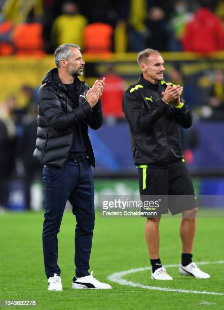Marco Rose , Head Coach of Borussia Dortmund and Alexander Zickler, Assistant Coach of Borussia Dortmund applaud the fans following victory in the...