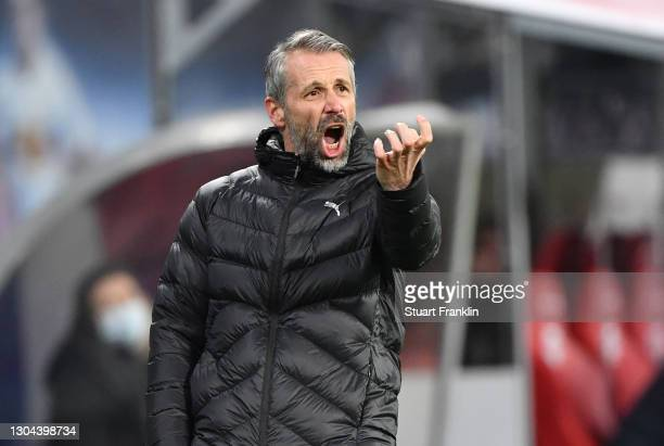 Marco Rose, Head Coach of Borussia Moenchengladbach gives his team instructions during the Bundesliga match between RB Leipzig and Borussia...