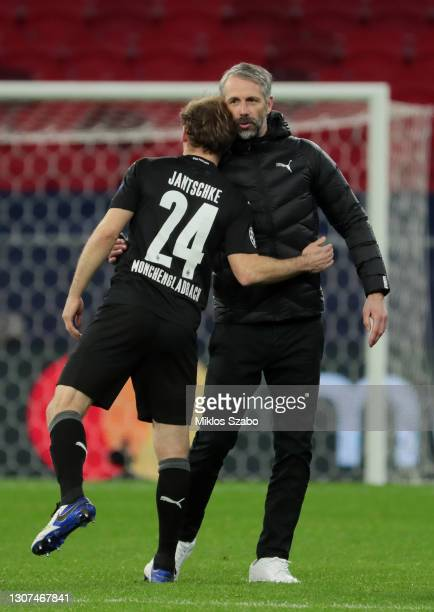 Marco Rose, Head Coach of Borussia Moenchengladbach interacts with Tony Jantschke after the UEFA Champions League Round of 16 match between...