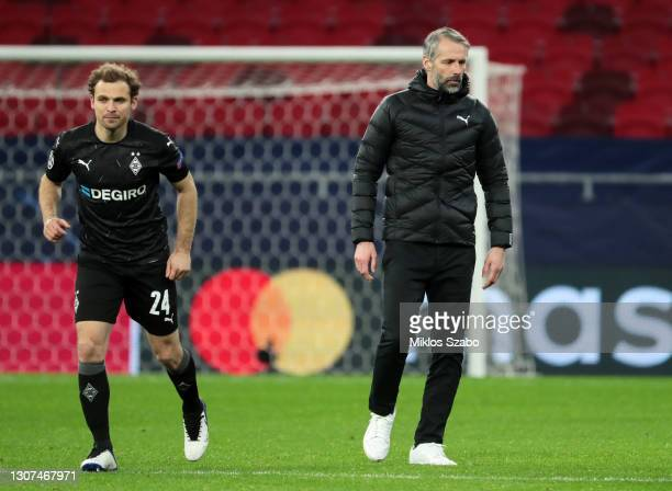 Marco Rose , Head Coach of Borussia Moenchengladbach looks on with Tony Jantschke of Borussia Moenchengladbach following the UEFA Champions League...