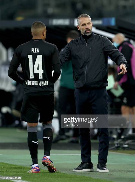 Marco Rose Head Coach of Borussia Moenchengladbach speaks to Alassane Plea of Borussia Moenchengladbach during the UEFA Champions League Group B...