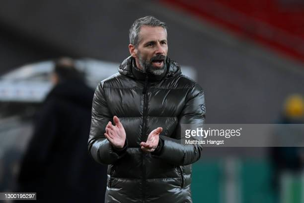 Marco Rose, Head Coach of Borussia Monchengladbach applauds during the DFB Cup Round of Sixteen match between VfB Stuttgart and Borussia...