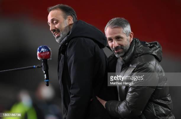 Marco Rose , Head Coach of Borussia Monchengladbach interacts with Pellegrino Matarazzo, Head Coach of VfB Stuttgart as he speaks to the media ahead...