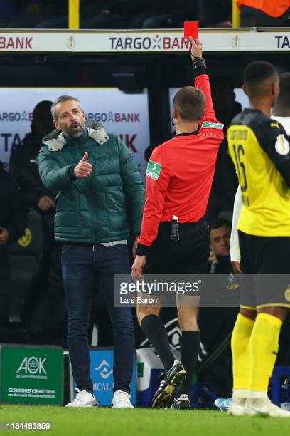 Marco Rose Head Coach of Borussia Monchengladbach is shown a red card by referee Benjamin Cortus during the DFB Cup second round match between...