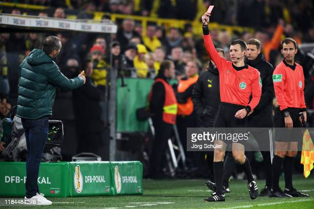 Marco Rose, Head Coach of Borussia Monchengladbach is shown a red card by referee Benjamin Cortus during the DFB Cup second round match between...
