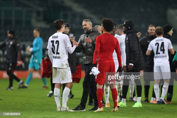 Marco Rose, Manager of Moenchengldbach celebrates with Florian Neuhaus to the Bundesliga match between Borussia Moenchengladbach and FC Bayern...