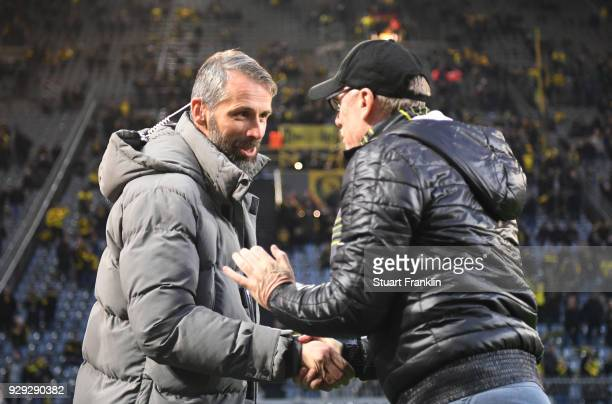 Marco Rose manager of Red Bull Salzburg and Peter Stoeger head coach of Borussia Dortmund shake hands prior to the UEFA Europa League Round of 16...