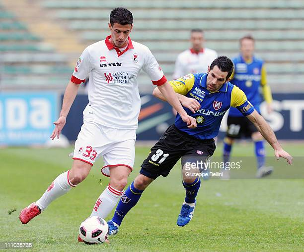 Marco Rossi of Bari shields the ball from Sergio Pellissier of Chievo Verona during the Serie A match between AS Bari and AC Chievo Verona at Stadio...