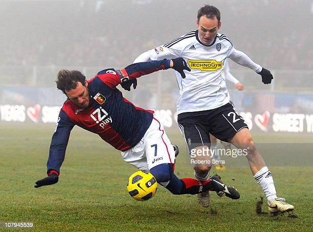 Marco Rossi of Genoa falls in a clash with Steve von Bergen of Cesena during the Serie A match between AC Cesena and Genoa CFC at Dino Manuzzi...