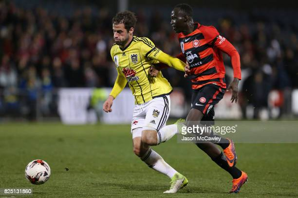 Marco Rossi of the Phoenix and Abraham Majok of the Wanderers compete for the ball during the FFA Cup round of 32 match between the Western Sydney...