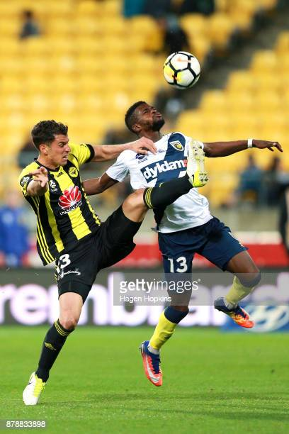 Marco Rossi of the Phoenix and Kwabena AppiahKubi of the Mariners compete for the ball during the round eight ALeague match between the Wellington...