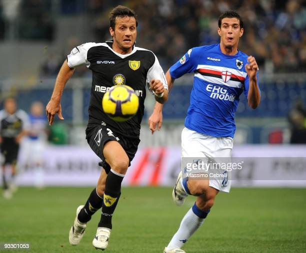 Marco Rossi of UC Sampdoria battles for the ball against Elvis Abbruscato of AC Chievo Verona during the Serie A match between UC Sampdoria and AC...