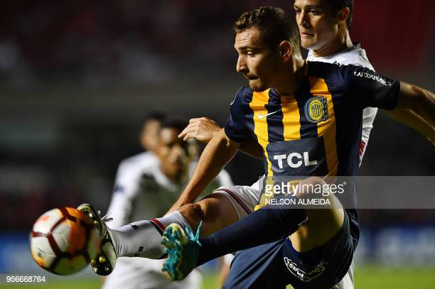 Marco Ruben of Argentina's Rosario Central vies for the ball with Anderson Martins of Brazil's Sao Paulo during their 2018 Copa Sudamericana football...