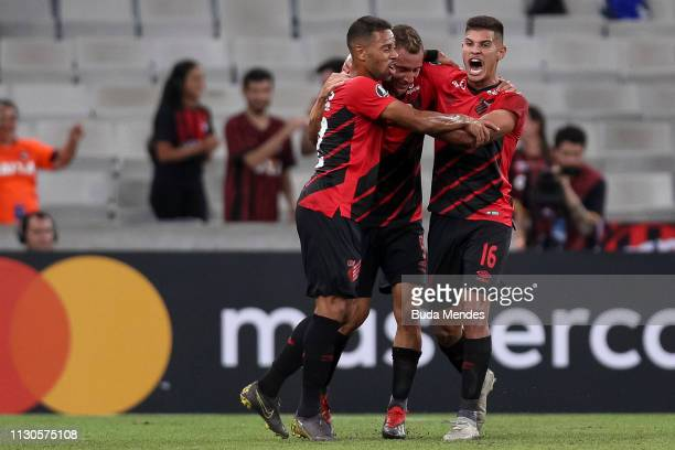 Marco Ruben of Athletico PR celebrates with his teammates after scoring the opening goal during a match between Athletico PR and Jorge Wilstermann as...