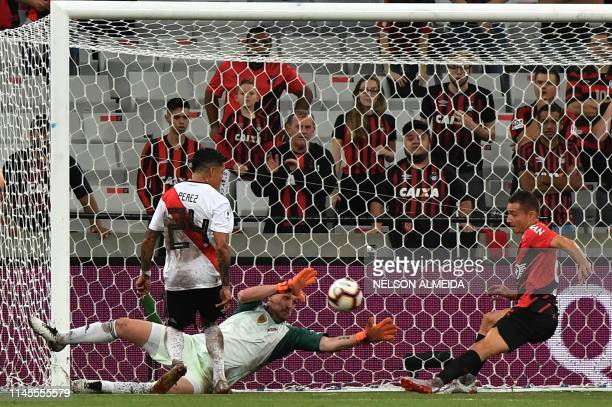 Marco Ruben of Brazil's Athletico Paranaense kicks to score against Argentina's River Plate during a Recopa Sudamericana 2019 first leg football...