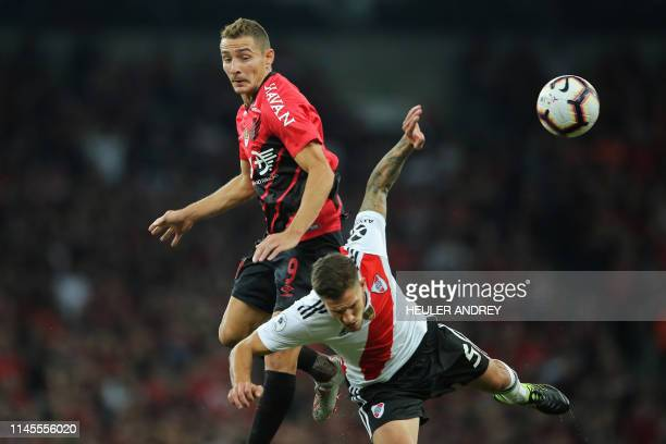 TOPSHOT Marco Ruben of Brazil's Athletico Paranaense struggles for the ball with Bruno Zuculini of Argentinas's River Plate during a Recopa...