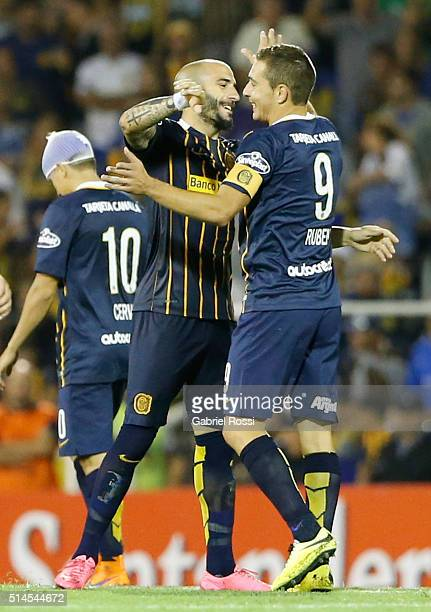 Marco Ruben of Rosario Central celebrates with Javier Pinola after scoring his team's fourth goal during a match between Rosario Central and River...