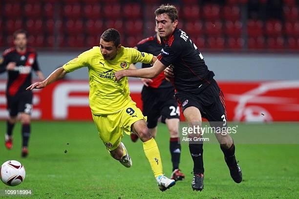 Marco Ruben of Villarreal is challenged by Stefan Reinartz of Leverkusen during the UEFA Europa League round of 16 first leg match between Bayer...