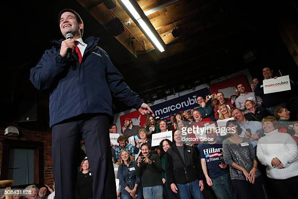 Marco Rubio jokes about a Hillary for Prison 2016 shirt worn by Robert Hodgman during a town hall event at Cara Irish Pub in Dover NH on Feb 3 2015