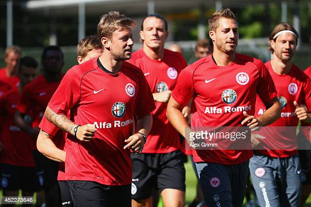 Marco Russ and Kevin Trapp run during an Eintracht Frankfurt training session at Commerzbank Arena on July 17 2014 in Frankfurt am Main Germany