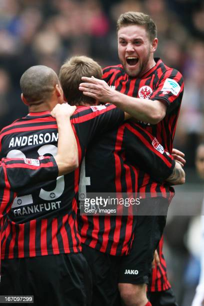 Marco Russ celebrates after scoring his team's first goal with Marc Stendera and Anderson of Frankfurt during the Bundesliga match between Eintracht...