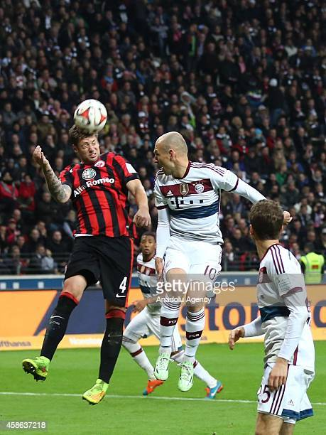 Marco Russ of Eintracht Frankfurt in action against Arjen Robben of Bayern München during the Bundesliga soccer match between Eintracht Frankfurt and...