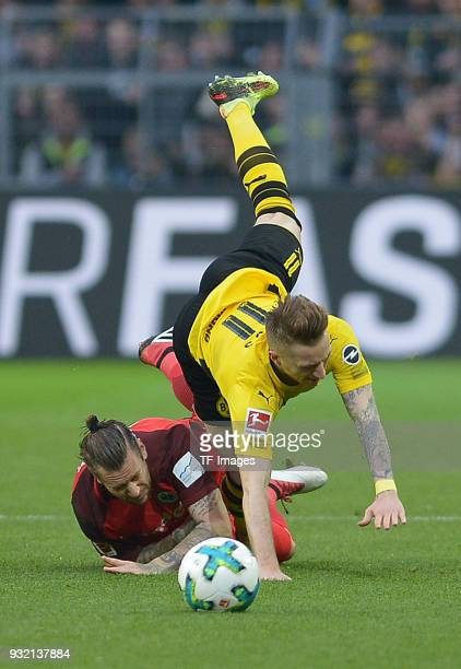 Marco Russ of Frankfurt and Marco Reus of Dortmund battle for the ball during the Bundesliga match between Borussia Dortmund and Eintracht Frankfurt...