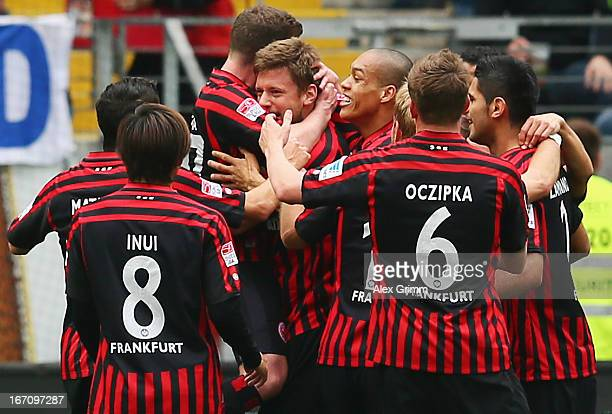Marco Russ of Frankfurt celebrates his team's first goal with team mates during the Bundesliga match between Eintracht Frankfurt and FC Schalke 04 at...