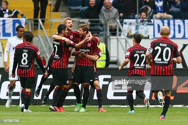 Marco Russ of Frankfurt celebrates his team's first goal with team mates during the Bundesliga match between Eintracht Frankfurt and FC Schalke 04 at...