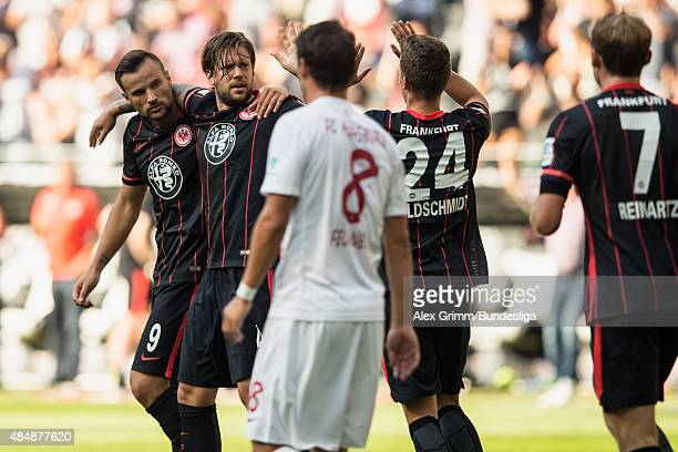 Marco Russ of Frankfurt celebrates his team's first goal with team mates Haris Seferovic Luca Waldschmidt and Stefan Reinartz as Markus Feulner of...