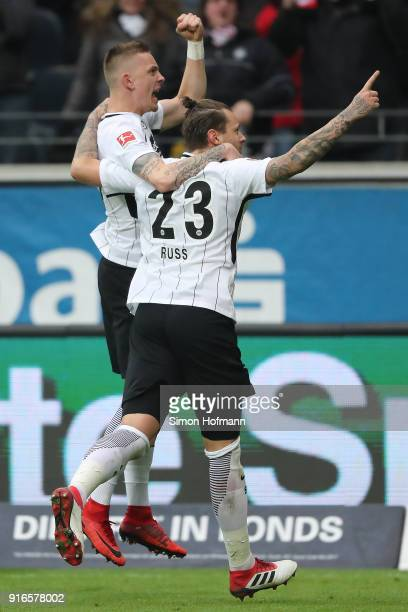 Marco Russ of Frankfurt celebrates with Marius Wolf of Frankfurt after he scored a goal to make it 21 during the Bundesliga match between Eintracht...