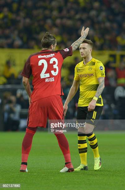 Marco Russ of Frankfurt gestures and Marco Reus of Dortmund looks on during the Bundesliga match between Borussia Dortmund and Eintracht Frankfurt at...