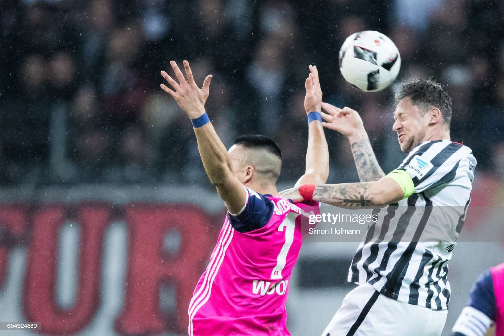 Marco Russ of Frankfurt jumps for a header with Bobby Shou Wood of Hamburg during the Bundesliga match between Eintracht Frankfurt and Hamburger SV at Commerzbank-Arena on March 18, 2017 in Frankfurt am Main, Germany.
