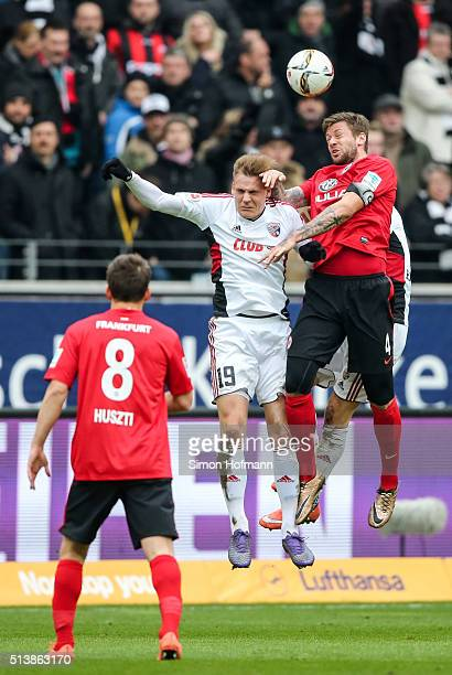 Marco Russ of Frankfurt jumps for a header with Max Christiansen of Ingolstadt during the Bundesliga match between Eintracht Frankfurt and FC...