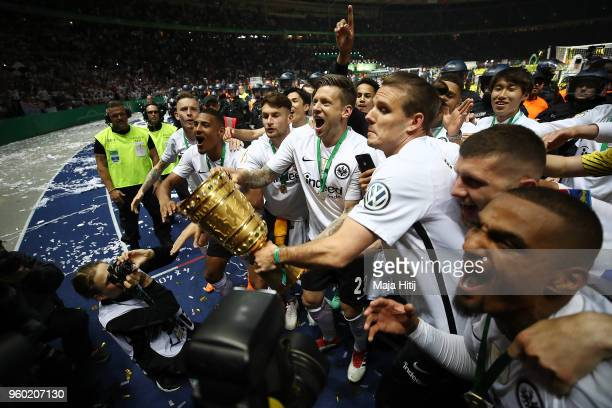 Marco Russ of Frankfurt lifts the trophy after the DFB Cup final between Bayern Muenchen and Eintracht Frankfurt at Olympiastadion on May 19 2018 in...