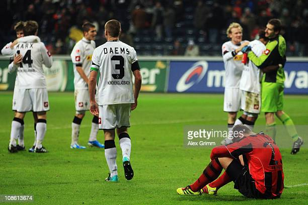 Marco Russ of Frankfurt reacts as players of M'Gladbach celebrate after the Bundesliga match between Eintracht Frankfurt and Borussia M'gladbach at...