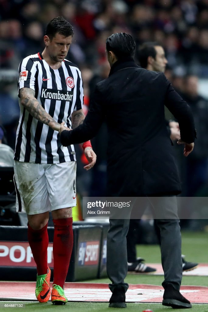 Marco Russ of Frankfurt shakes hands with head coach Niko Kovac during the Bundesliga match between Eintracht Frankfurt and Hamburger SV at Commerzbank-Arena on March 18, 2017 in Frankfurt am Main, Germany.