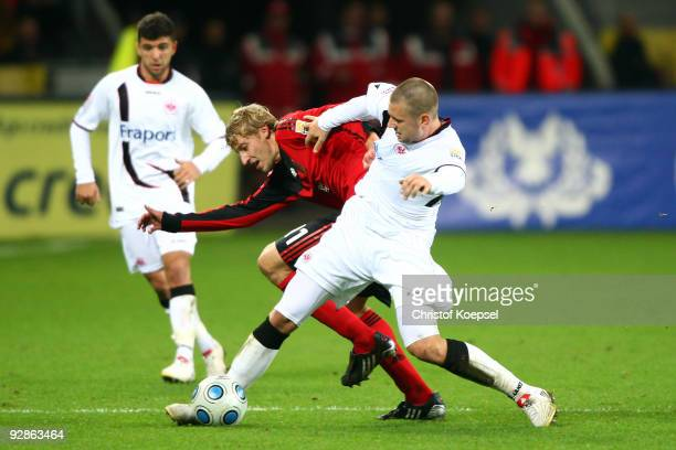 Marco Russ of Frankfurt tackles Stefan Kiessling of Leverkusen during the Bundesliga match between Bayer Leverkusen and Eintracht Frankfurt at the...