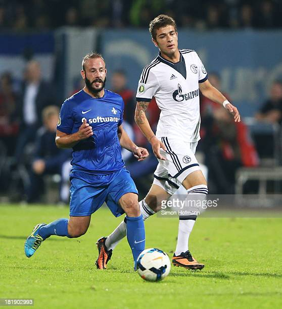 Marco Sailer of Darmstadt is challenged by Roman Neustaedter of Schalke during the DFB Cup second round match between Darmstadt 98 and Schalke 04 at...