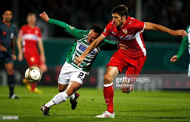 Marco Sailer of Greuther Fuerth is challenged by Matthieu Delpierre of Stuttgart during the DFB Cup match between SpVgg Greuther Fuerth and VfB...
