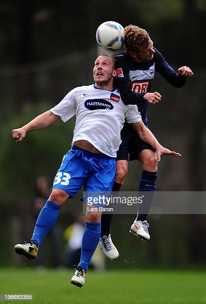 Marco Sailer of Heidenheim goes up for a header with Fabian Lustenberger of Berlin during the friendly match between Hertha BSC Berlin and 1. FC...