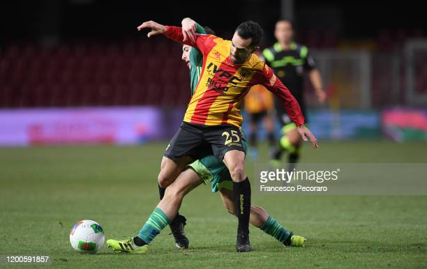 Marco Sau of Benevento Calcio vies for the ball with Samuele Birindelli of Pisa during the Serie B match between Benevento Calcio and Pisa at Stadio...