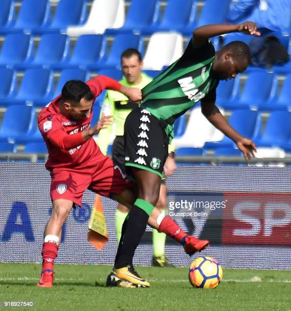 Marco Sau of Cagliari Calcio and Khouma Babacar of US Sassuolo in action during the serie A match between US Sassuolo and Cagliari Calcio at Mapei...