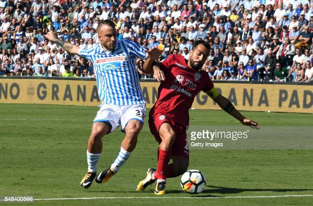 Marco Sau of Cagliari Calcio competes for the ball whit Filippo Costa of Spal during the Serie A match between Spal and Cagliari Calcio at Stadio...