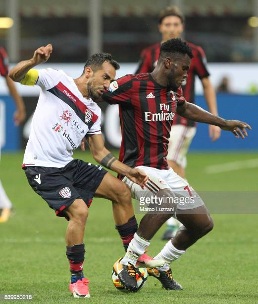 Marco Sau of Cagliari Calcio competes for the ball with Franck Kessie of AC Milan during the Serie A match between AC Milan and Cagliari Calcio at...