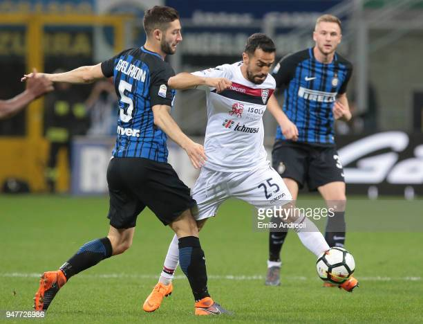 Marco Sau of Cagliari Calcio is challenged by Roberto Gagliardini of FC Internazionale Milano during the serie A match between FC Internazionale and...