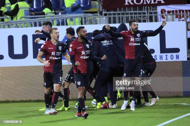 Marco Sau of Cagliari celebrates his goal 2 2 with the team mates during the Serie A match between Cagliari and AS Roma at Sardegna Arena on December...